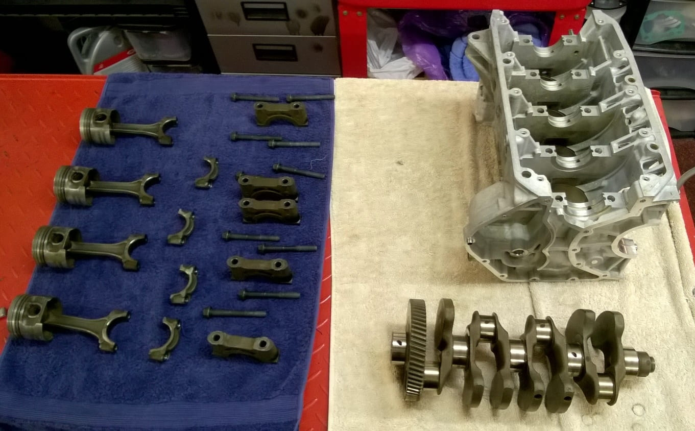Crank, block, rods and pistons cleaned for inspection
